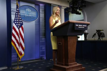 """The Trump White House is firing back at Maryland Gov. Larry Hogan, saying his recent sharp criticism of President Donald Trump's coronavirus pandemic response amounts to """"revisionist history."""" White House press secretary Kayleigh McEnany speaks Thursday during a press briefing at the White House in Washington."""