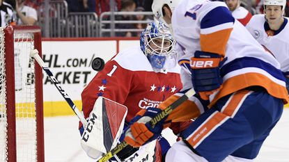 Capitals goaltender Pheonix Copley watches the puck against Islanders right wing Cal Clutterbuck during the first period of Saturday night's game.