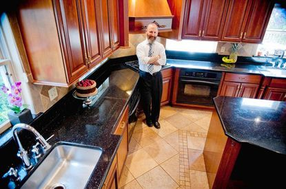 Saul Horowitz owns Syata Kitchens and designed this kosher kitchen for his family, including two ovens for cooking dairy and meat separate and two sinks for the same purpose.