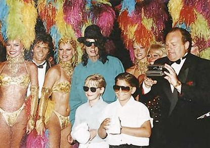 After a late-night private show, showgirls and entertainers posed with Michael Jackson, Macaulay Culkin (left front), Brock Goldstein and Alan and Lynn Goldstein (far right) during a 1991 Goldstein family trip with Culkin and Jackson.