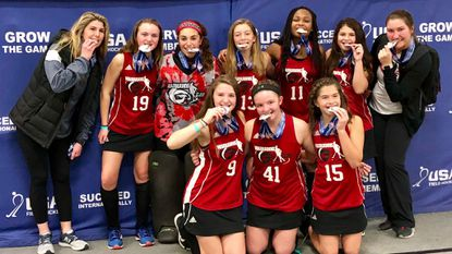 The Howard County Warhawks U14 field hockey squad poses for a photo after winning gold at the USA Field Hockey National Indoor Championships.