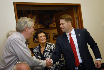 "Baltimore City Council Members, Robert Curran and Rochelle ""Rikki"" Spector greet William H. Cole IV (left to right) before the City Council Luncheon."