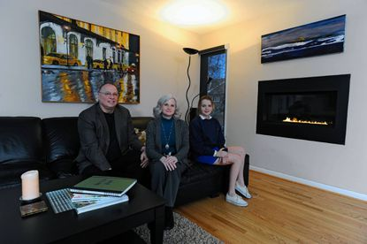Caroline and Tim Ingles'and their 12-year-old daughter Hallie are pictured in the great room.