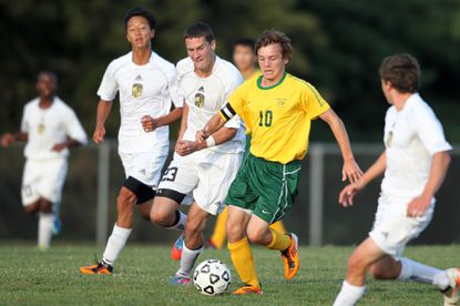 Mt. Hebron's Brian Shade, second from left, defends Wilde Lake's Brian Dubois.