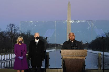 In this Tuesday, Jan. 19, 2021 file photo, Joe Biden and his wife, Jill, listen as Cardinal Wilton Gregory, Archbishop of Washington, delivers the invocation during a COVID-19 memorial at the Lincoln Memorial Reflecting Pool in Washington, D.C. Cardinal Gregory has made clear that President Biden, who sometimes worships in Washington, is welcome to receive communion at the archdiocese's churches. (AP Photo/Alex Brandon, File)