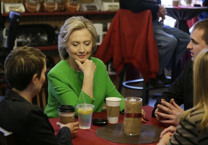 Democratic presidential candidate Hillary Rodham Clinton meets with local residents at the Jones St. Java House, Tuesday, April 14, 2015, in LeClaire, Iowa.