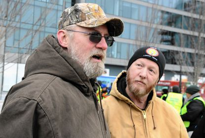 From left, David Kelly, Aberdeen, a BEG service operator, speaks about his desire for union representation as Troy Johnson, international representative with IBEW listens. IBEW organizers and some BGE workers rally at the Exelon building in advance of vote to unionize.