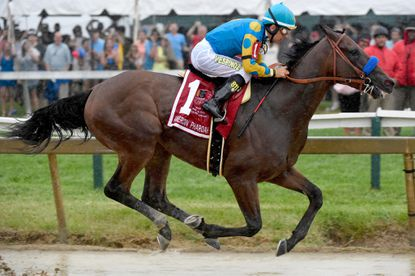 Victor Espinoza rides American Pharoah, who could claim the Triple Crown with a win in Saturday's Belmont Stakes, to victory in the Preakness Stakes at Pimlico in Baltimore on May 16.