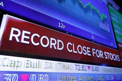 A television screen on the trading floor of the New York Stock Exchange headlines the closing Dow Jones industrial average, File. (AP Photo/Richard Drew)