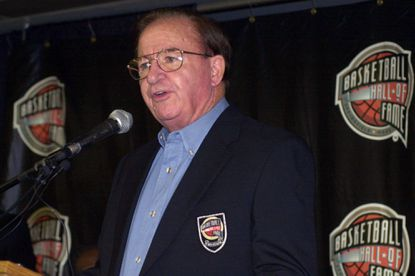 In this Oct. 13, 2000, file photo, Morgan Wootten speaks after being inducted into the Basketball Hall of Fame in Springfield, Mass. Wootten, who built DeMatha High School into a national powerhouse and mentored several future NBA stars during a career that spanned parts of six decades, has died. He was 88.