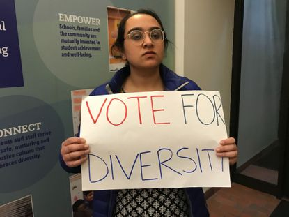 Japsimran Kaye of Clarksville, a 2014 graduate of River Hill High School, supports diversity and redistricting during a Howard County School Board meeting last November. File.
