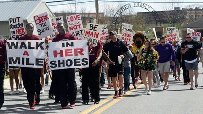 Participants exit Dutterer Family Park on their mile-long walk to Westminster City Park during the 2015 Walk a Mile in Her Shoes event in Westminster. Proceeds from the event benefit the Rape Crisis Intervention Service of Carroll County. This year's event is set for April 14.