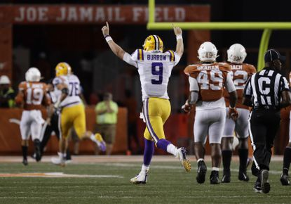 LSU quarterback Joe Burrow (9) celebrates after connecting with wide receiver Justin Jefferson for a touchdown against Texas during the second half of an NCAA college football game Saturday, Sept. 7, 2019, in Austin, Texas.