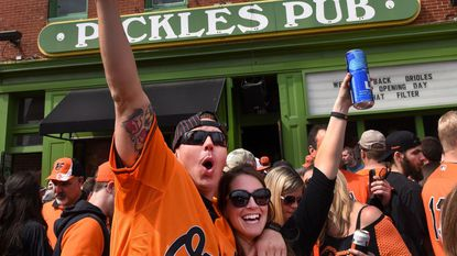 Scott and Amy Munck of Arbutus celebrate the Orioles' 2017 Opening Day outside Pickles Pub. Pickles is offering a free breakfast buffet for Opening Day this year.