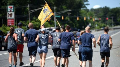 Law enforcement officers from a host of local agencies as well as members of the Harford County Running Club carry the Law Enforcement Torch along Rt. 40 Tuesday afternoon. The torch will make its way to Howard County Thursday.