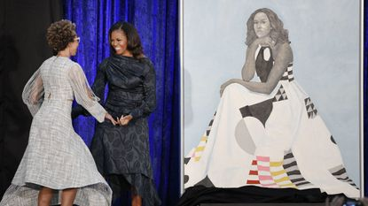 Former first lady Michelle Obama with artist Amy Sherald after unveiling her official portrait at the National Portrait Gallery on Monday, Feb. 12, 2018 in Washington, D.C.