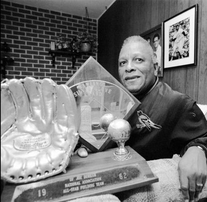 Joe Durham with his 1962 Silver Glove Award in 1995. Durham, the firstAfrican-American player to homer for the Orioles, died Thursday, April 28, 2016, at age 84.