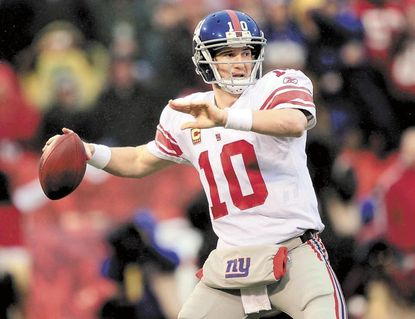 New York Giants quarterback Eli Manning will lead his team into a Super Bowl XLVI matchup against the New England Patriots Sunday in Indianapolis. Social media experts said aggressive advertising campaigns online will also be worth watching.