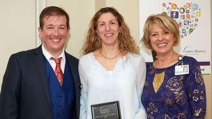 2018 Carroll Hospital Advanced Practice Provider of the Year Kim Baker flanked by Vice President of Medical Affairs Dr. Mark Olszyk and Hospital President Leslie Simmons.