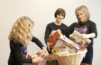 Volunteers with Columbia-based The Little Things for Cancer assemble gift baskets for the families of cancer patients.