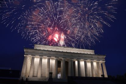 Fireworks go off over the Lincoln Memorial in Washington, Thursday, July 4, 2019. The Trump administration is promising one of the largest fireworks displays in recent memory for Washington on July 4. It also plans to give away as many as 300,000 face masks to those who come down to the National Mall, although they won't be required to wear them. (AP Photo/Susan Walsh)