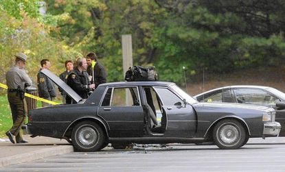 A family member identified Scot Horn, at far right, shown with other FBI investigators surrounding a car that John Muhammad and Lee Boyd Malvo were found in on Oct. 24, 2002, during the investigation of the Washington-area sniper case.