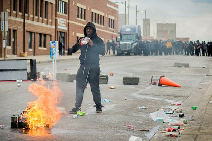 The ATF released a version of this photo of Donta Betts taken during the April 27 riots. Betts faces several federal charges, including attempted arson.