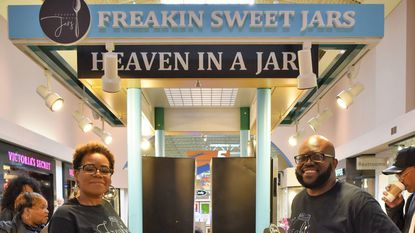 Jaheel and Renate Garrett showcase their new business, Freakin' Sweet Jars, at the grand opening held Oct. 26 at Arundel Mills Mall in Hanover.