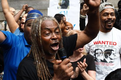 Protesters celebrate outside the courthouse after a judge ruled the Freddie Gray trial will remain in Baltimore.