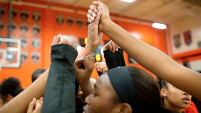 Oakland Mills, seen huddling before the start of the basketball game earlier this winter, improved to 3-0 overall with a win over Glenelg on Tuesday.