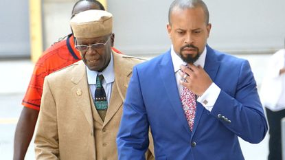 Sen. Nathaniel Oaks, center, along with his attorneys walk into federal court Tuesday.