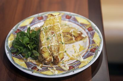 """There are sweet mountains to climb at <a href=""""http://findlocal.baltimoresun.com/listings/miss-shirleys-cafe-baltimore"""">Miss Shirley's</a>, French toast stuffed with coconut cream or strawberry cheesecake. But the Everest of calories at Baltimore's beloved breakfast stop is the Crab Cristo -- jumbo-lump crab meat, smoked ham and Swiss cheese, sandwiched in French Toast, deep-fried and drizzled with a creamy honey mustard and citrus aioli. Finally, chef Brigitte Bledsoe's sweet-and-salty fantasia gets dusted with powdered sugar and Old Bay. It's the best version of the Monte Cristo since the old days at Gampy's, when the fried sandwiches were dipped in blueberry sauce."""