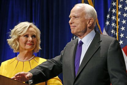 Sen. John McCain, R-Ariz., right, pauses as his wife Cindy McCain looks at him on stage after giving a victory speech on Nov. 8, 2016, in Phoenix. McCain would die before completing his term.