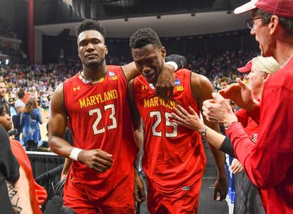 """Bruno Fernando, left, comforts teammate Jalen Smith after LSU beat Maryland, 69-67, to oust the Terrapins from the NCAA Tournament on Saturday. """"He feels like the last play was his fault,"""" said sophomore guard Darryl Morsell of Smith. """"He played his tail off."""""""