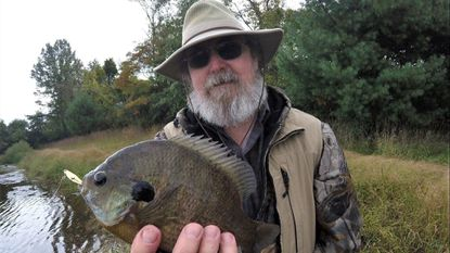 Tom Gronaw shows that flutter spoons can be quite effective for autumn panfish like this big bluegill.