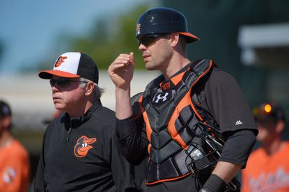 Orioles manager Buck Showalter listens to catcher Matt Wieters during spring training at the Ed Smith Stadium complex.