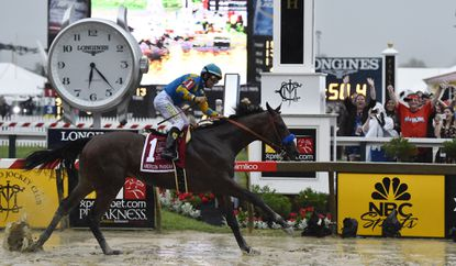 American Pharoah, ridden by Victor Espinoza, wins the 140th Preakness at Pimlico Race Course on Saturday.