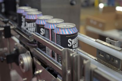 Relabeled cans from unused cans sold by a cider canning company move toward the end of the canning line at Duclaw Brewing Co. Tue., Sept. 29, 2020. (Karl Merton Ferron/Baltimore Sun Staff)