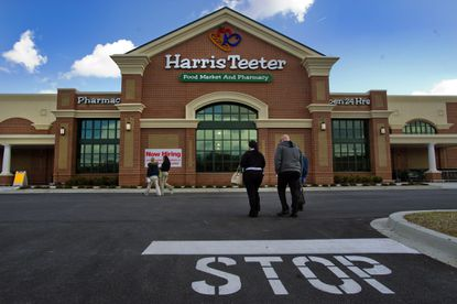 Store associates head into the Harris Teeter location in Ellicott City.
