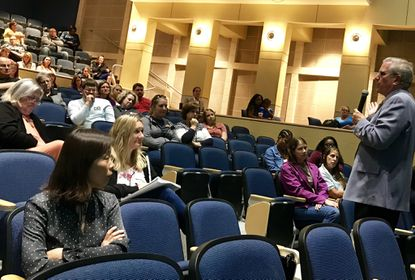 "Dr. Leonard Sax, author, physician and psychologist, addresses Harford County parents during his recent ""Instagram Ate My Daughter, My Son Won't Stop Playing Fortnite, What Can I Do?"" presentation at Bel Air High School."