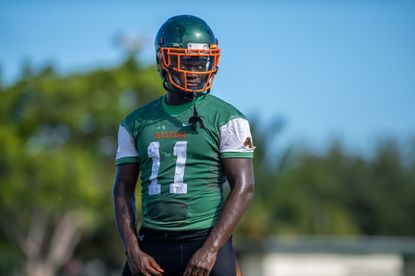 McArthur High's Ruben Hyppolite stands in the heat during the first day of fall practice in Hollywood on July 29, 2019.
