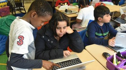 Students at Bedford Elementary School in Baltimore County work together. The county school board says schools throughout the county need more money, and it is asking for a nearly 15 percent increase in spending next year.