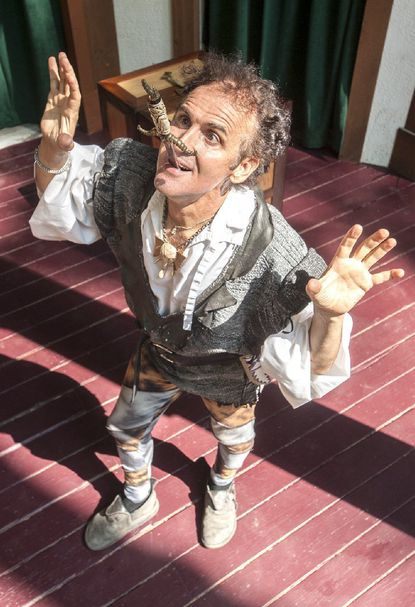 """Connecticut magician and sword swallower Johnny Fox proves that some acts are not just an illusion or trick, but a honed skill. Fox carefully ingests the 18"""" steel blade during a rehearsal Thursday afternoon at the Maryland Renaissance Festival in Crownsville."""