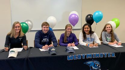 Westminster recognized five seniors for making college commitments to play lacrosse. From left, Anna Ruby (Loyola), Christian Etchison (Mount St. Mary's), Hannah Dintino (Furman), Haleigh Moore (Johns Hopkins), and Jessica Hise (Manhattan).