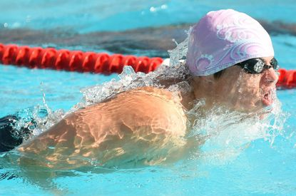West Laurel's Henry Buda swims in the boys 18-and-under 50-meter butterfly in a meet won by Montpelier 290-276