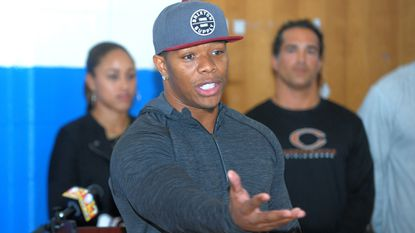 Former Ravens player Ray Rice visited Samuel F. B. Morse Elementary School with his wife, Janay Palmer in background, in 2015.