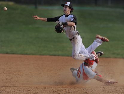 Archbishop Spalding shortstop Kevin Heiss gets the force at second.