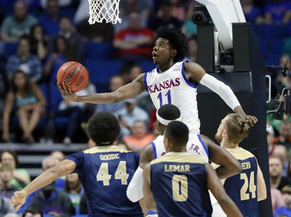 Josh Jackson, who played for the University of Kansas for one season, has signed with Under Armour.