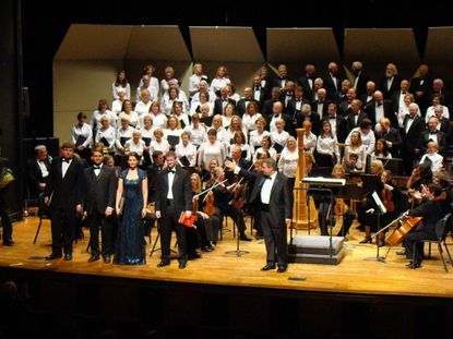 From left, tenor David Merrill, baritone Nathan Wyatt, soprano Caitlin Vincent and countertenor Chris Dudley are acknowledged by J. Ernest Green, center, conducting the Annapolis Chorale and Chamber Orchestra at the Nov. 9 performance at Maryland Hall.