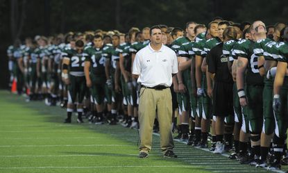 Stevenson head coach Ed Hottle during the National Anthem in 2011.